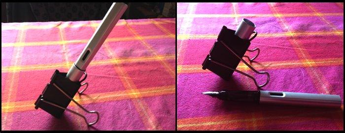 Eine Foldback-Klammer als Stifthalter, auf einem Tisch stehend